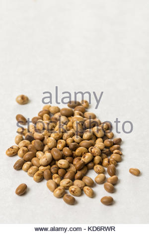 Pile of soya beans isolated above white marble background with copy space. - Stock Image
