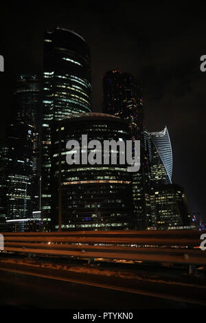 Business center in a large city with high skyscrapers in the evening - Stock Image