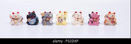 Maneki neko cats. Traditional Japanese souvenir set. - Stock Image