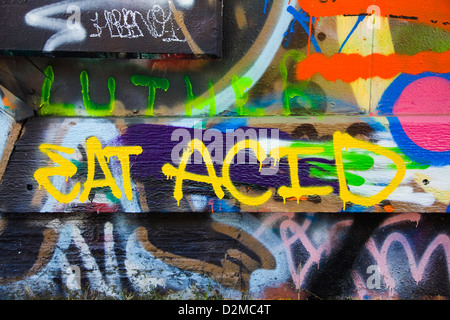 eat acid tagged on wall - Stock Image