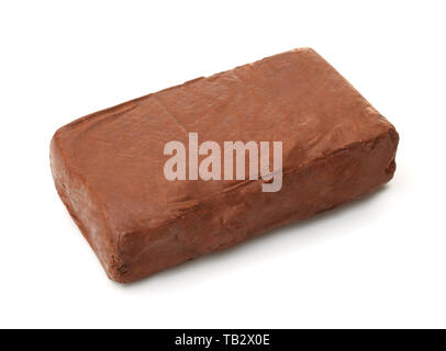 Piece of natural raw red modeling clay isolated on white - Stock Image