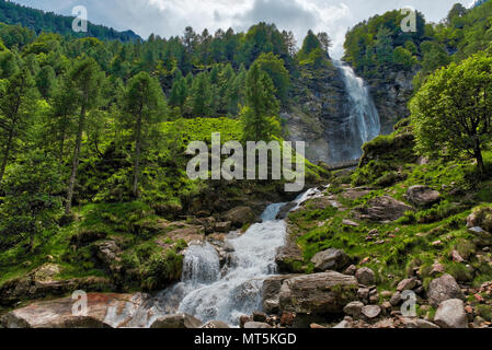 Big Waterfall in the forest, spring season near the little ancient village of Sonogno in Switzerland - Stock Image