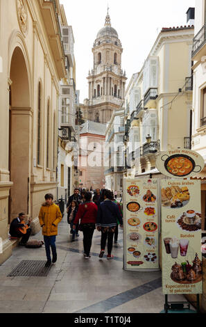 Malaga street scene - in the backstreets of malaga old town, with the  belltower of Malaga Cathedral, Malaga, Andalusia Spain - Stock Image