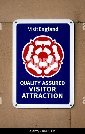 A sign or Notice placed by Visit England by the entrance to a museum advising that it is a Quality Assured Visitor Attraction - Stock Image
