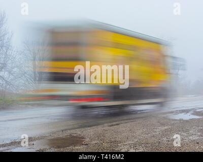 Long exposure truck passing-by blurry image photo - Stock Image