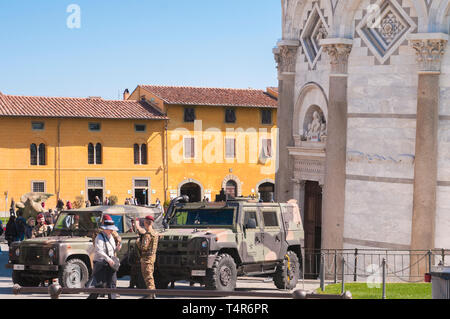 PISA, ITALY - APRIL, 15 2019: Italian military guarding the Leaning Tower of Pisa to prevent terrorist attacks - Stock Image