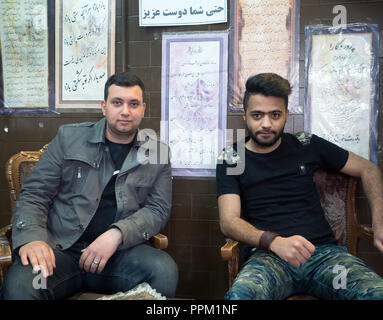 Meybod, Iran - March 6, 2017 : portrait of two guys in a local cafè - Stock Image