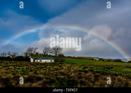 Ardara, County Donegal, Ireland. 20th March 2019. A rainbow appears on a morning of sunshine and showers on the north-west coast. Credit: Richard Wayman/Alamy Live News - Stock Image