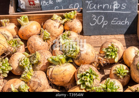 A wooden box of turnips for sale. - Stock Image