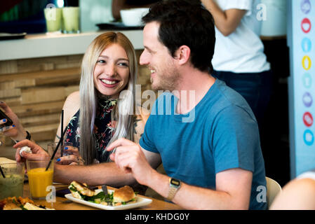 Friends having meal together at restaurant - Stock Image