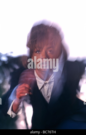African American business woman in suit with movement - Stock Image