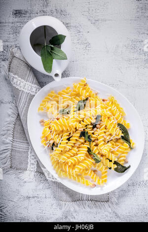 Fusilli pasta with sage and pine nuts. Gluten free. Flour from rice and corn flour - Stock Image