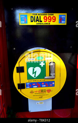 Defibrillator in a disused public phone box, Boughton Monchelsea village, Kent, England. - Stock Image