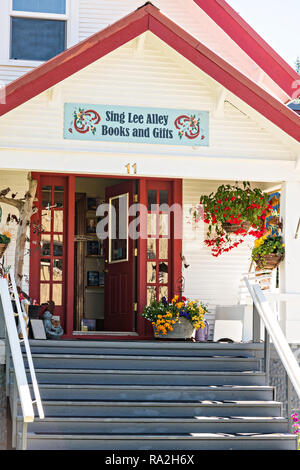 Sing Lee Alley Books & Gift shop in the tiny village of Petersburg on Mitkof Island, Alaska. Petersburg settled by Norwegian immigrant Peter Buschmann is known as Little Norway due to the high percentage of people of Scandinavian origin. - Stock Image