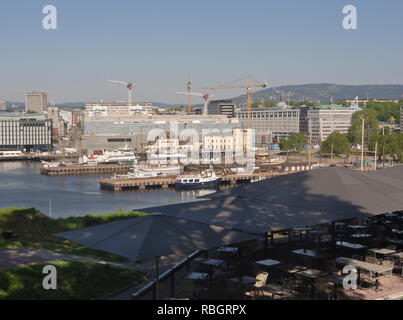 Aker brygge and the construction of the new National Art Museum seen from Festningen restaurant on the ramparts of the Akershus fortress, Oslo Norway - Stock Image