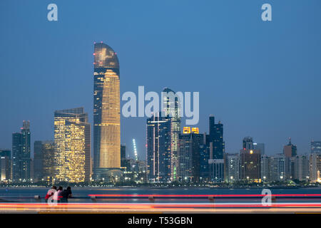Unidentified people watching the Iconic view of Abu Dhabi Seascape, UAE - Stock Image