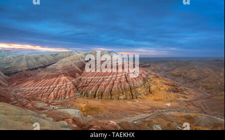Panoramic view of Aktau Mountains on sunrise, located in Altyn Emel National Park, Kazakhstan - Stock Image