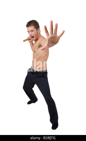 man doing martial arts move on white background - Stock Image