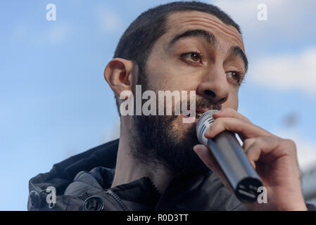 London, UK. 3rd November 2018. Spoken word artist Potent Whisper performs his poem on Regeneration. Several hundred people, mainly from London's council estates under threat of demolition by Labour London councils came to a protest outside City Hall called by 'Axe the Housing Act'. The protest called for an end to estate demolitions unless  approved by a ballot of all residents, and for public land to be used to build more council homes rather than being turned over to developers to make huge profits from high-priced flats. Speaker after speaker from estate after estate got up and spoke about  - Stock Image