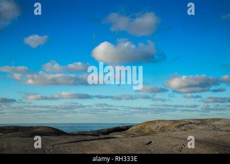 Flat rock by ocean - Stock Image