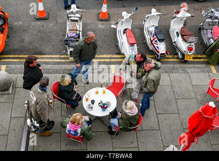 Brighton UK 6th May 2019 - A group of Mods wrap up warm on Brighton seafront as they enjoy the May Bank Holiday with unsettled cool conditions forecast to continue throughout Britain over the next few days. Credit: Simon Dack / Alamy Live News - Stock Image