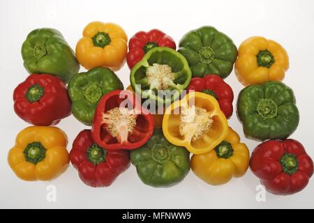 Green, yellow and red peppers. White background. Studio shot.       Ref: CRB538_103609_0035  COMPULSORY CREDIT: Martin Harvey / Photoshot - Stock Image