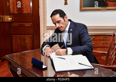 Qatari Foreign Minister Sheikh Mohammed bin Abdulrahman Al Thani signs U.S. Secretary of State Michael R. Pompeo's guestbook before their meeting at the U.S. Department of State in Washington, D.C., on June 26, 2018. - Stock Image