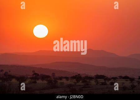Africa, Namibia, Damaraland. Orange sunset over mountains. Credit as: Wendy Kaveney / Jaynes Gallery / DanitaDelimont.com - Stock Image