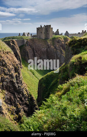 Cliffs at Burn of Halymyres stream leading to Tower House of Donnottar Castle 13th Century ruins near Stonehaven Scotland UK - Stock Image