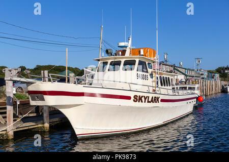Head boat 'Skylark' docked at Dutcher dock in Menemsha Basin, in the fishing village of Menemsha in Chilmark, Massachusetts on Martha's Vineyard. - Stock Image