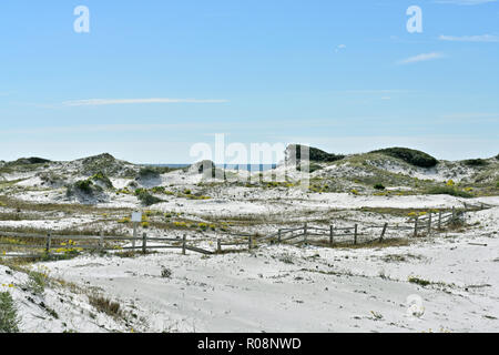 Florida coastal white sand dunes and a split rail fence near the Gulf coast beach at Watersound Florida, USA. - Stock Image