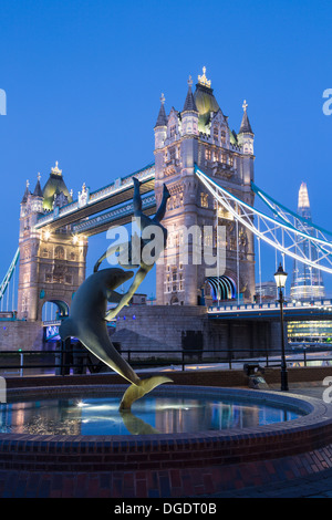 Tower Bridge dolphin statue and The Shard at twilight London - Stock Image