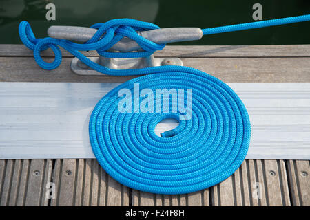 Southampton, UK. 11th September 2015. Southampton Boat Show 2015. A neatly coiled length of mooring line holding - Stock Image