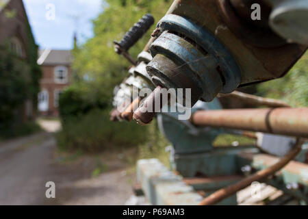A vintage, rusty 6 head wood copy pantograph machine, abandoned outside a derelict furniture factory in Norwich, UK. - Stock Image