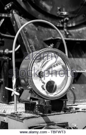 Front lamp of a old locomotive in black and white - Stock Image