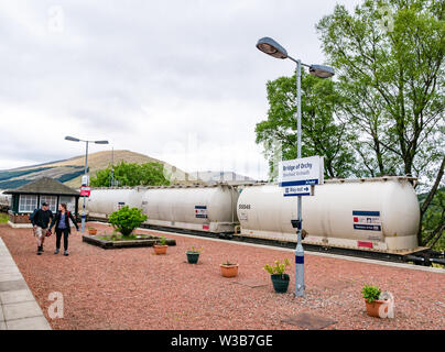 ScotRail Bridge of Orchy rural train station platform with freight train containers on West Highland railway line, Scottish Highlands Scotland, UK - Stock Image