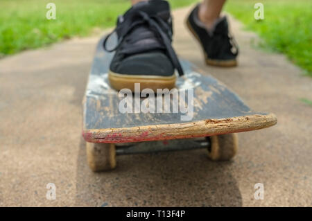 closeup of a skateboard going towards the camera, low angle view. - Stock Image