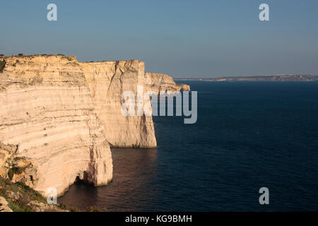 Sanap Cliffs, Gozo, with Comino and Malta visible in the distance - Stock Image