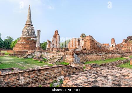Ancient ruins of pagoda at Wat Phra Mahathat temple is a famous attractions in Phra Nakhon Si Ayutthaya Historical - Stock Image