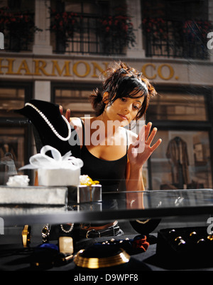 lady in a jewelry store - Stock Image