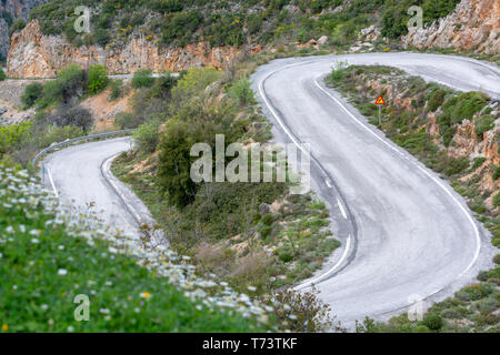 Driving car on S shape winding roads of Peloponnese, roads network in Greece, vacation and tourist destination - Stock Image