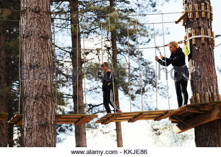 mother and son on high ropes - Stock Image