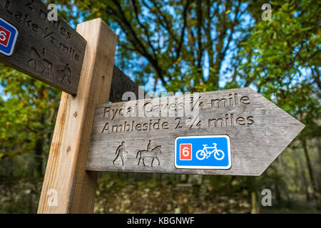 wooden signpost, directions to rydal cave,ambleside,lake district,cumbria,england,uk - Stock Image
