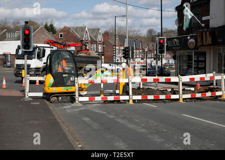 Roadworks digging up the road, Closing it. in Sheffield England - Stock Image