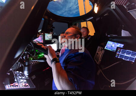 Commercial Crew Program astronauts Mike Fincke, Nicole Mann and Butch Wilmore train inside the SES Alpha Cupola simulator in Free Flyer Track Capture Sim training at the Johnson Space Center February 20, 2019 in Houston, Texas. - Stock Image