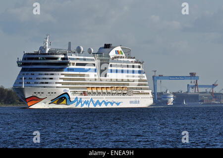 First AIDA-Cruises double-call to the port of Kiel: AIDAluna and AIDAcara leave the port bound for Norway and Klaipeda. - Stock Image