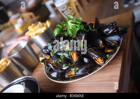 Bowl of mussels for lunch in The Cobb Arms Lyme Regis West Dorset UK - Stock Image