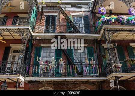 Mardi Gras New Orleans, view of skeletons and colorful throws (beads) decorating a balcony during Mardi Gras in the French Quarter, New Orleans, USA - Stock Image