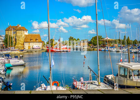 Boats, yachts and fishing vessels line the old harbor or Vieux Bassin in the Normandy village of Honfleur, France on a sunny summer day. - Stock Image
