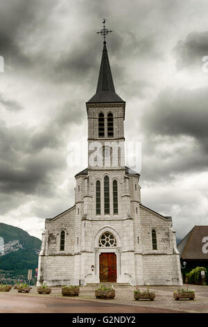 A lovely little church on the outskirts of Lac de Annecy in the French Alps. - Stock Image
